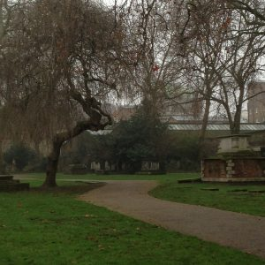 Park in London with bent tree